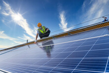 Technician Checking The Maintenance Of The Solar Panels On Roof, Solar Energy