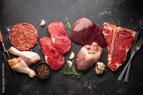 Fotografija Selection of assorted raw meat food with seasonings for zero carb carnivore diet
