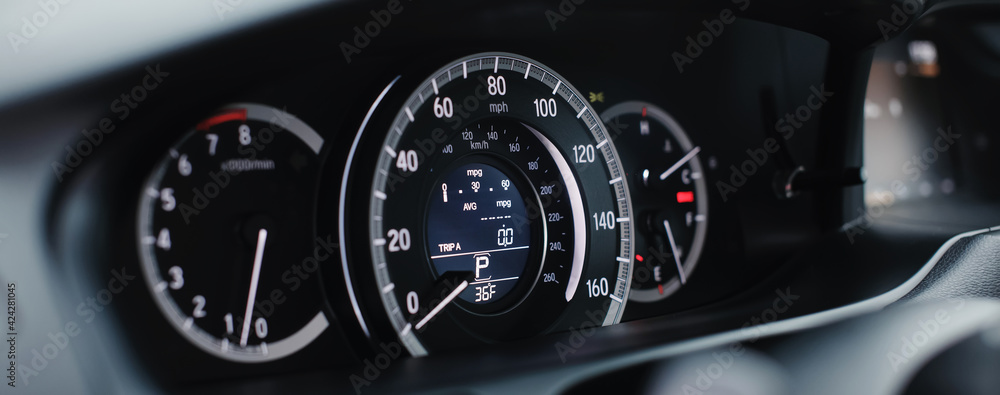 Miles Speedometer of Modern car close up.