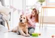Little girl with golden retriever dog at Easter
