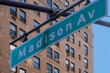 Hanging Green And White City Street Sign Of Madison Ave, Avenue