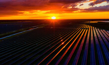 Aerial View Of A Solar Panel Field At Sunset, Micco, Florida, United States.