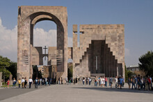 In Vagharshapat, Armenia, Visitors Enter The Holy See Of Echmiadzin Through The Main Gate With Its Adjoining Papal Visit Monument.