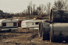 Abandoned, White Trailers. At The Junkyard Of Used Cars. House On Wheels