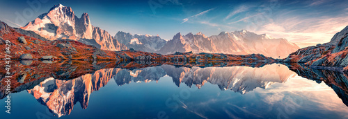 Fototapeta Panoramic autumn view of Cheserys lake with Mount Blank on background, Chamonix location. Spectacular outdoor scene of Vallon de Berard Nature Preserve, Alps, France, Europe. obraz