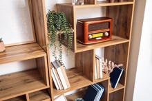 Modern Shelf Unit With Books And Retro Radio Receiver, Closeup