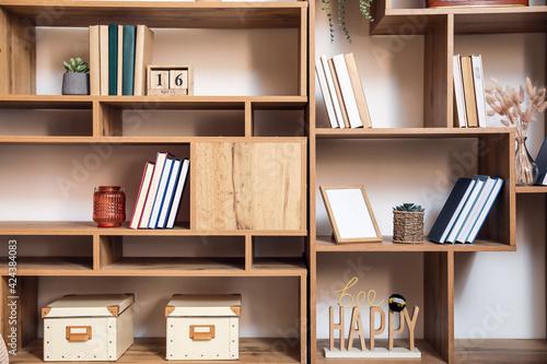 Fényképezés Modern shelf units with books and decor, closeup