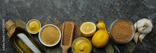 Fototapeta Concept of cooking mustard on black smoky background, top view obraz