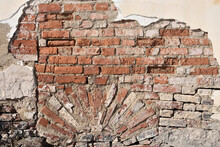Old Brick Wall With Remnants Of Plaster