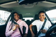 Beautiful Young African Women Is Fastening Seat Belts And Smiling While Travelling By Car