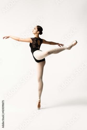 Fototapeta Beautiful japanese ballerina posing on white background