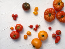 A Variety Of Heirloom Tomatoes In Sunshine