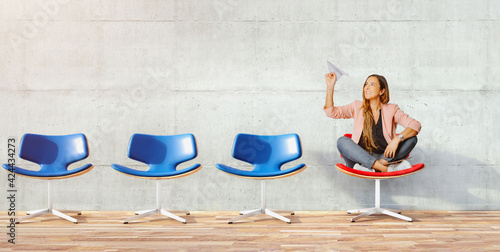 Obraz  Young beautiful woman holding hand model paper air plane. Design of travel concept with air plane on empty gray color background - fototapety do salonu