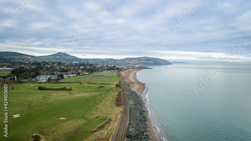 Fotografie, Obraz Aerial View of Golf Course, Greystones and Mountains and Irish Sea