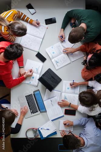 Obraz na płótnie students use modern technology for a school project