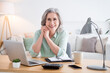 Portrait of pretty friendly person sit behind desktop arms on cheek beaming smile look camera home indoors