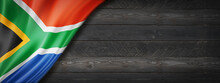 South African Flag On Black Wood Wall Banner