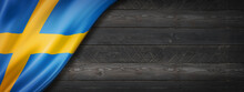 Swedish Flag On Black Wood Wall Banner