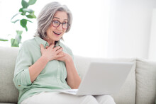 Portrait Of Impressed Positive Person Arms On Chest Open Mouth Look Interested Laptop Tv Series Free Time Indoors