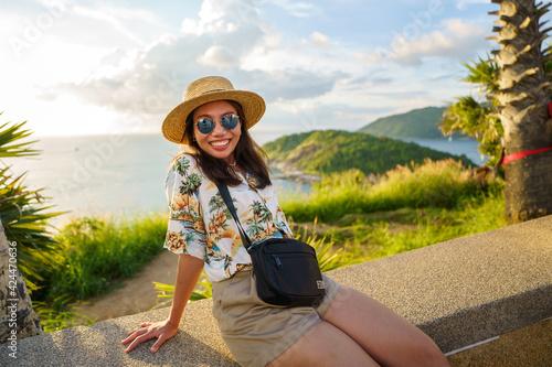 Fototapeta Travelers at Phromthep cape viewpoint at the south of Phuket Island, Thailand