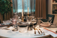 Restaurant. An Elegantly Laid Dining Table With Dishes And Cutlery For Several People. Close Up. Nobody