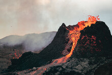 Volcanic Eruption In Iceland, Lava Bursting From The Volcano. Bright Red Magma.