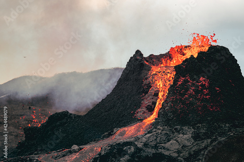 Slika na platnu Volcanic eruption in Iceland, lava bursting from the volcano