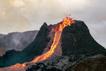 Volcanic Eruption In Iceland, Lava Bursting From The Volcano. Pouring Lava.