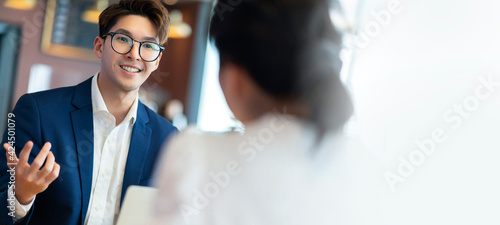 Obraz casual business meeting asian adult businessman formal suit consult strategy with female project founder partner startup business plan in cafe restaurant - fototapety do salonu