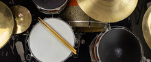 Musical Instruments Close Up Banner. Beautiful Snare Drum And Hi-hat Cymbals With Drummer Holding Drumsticks. Modern Drum Set. Music Shop.