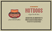 Handwritten Compressed Grunge Font. A Clean Font Is Included. The Letters Are Accompanied By A Version Of The Logo And The Hot Dog Icon. Vector Concept Of Fast Food.