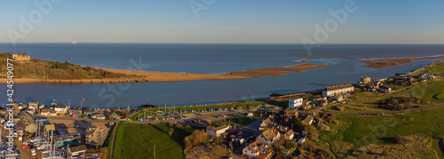 Photo A drone view of the estuary of the River Deben at Felixstowe Ferry in Suffolk, U