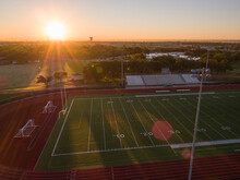Aerial Shot Of A High School Track And Football Field In Texas At Sunrise
