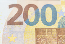 Two Hundred Euro Banknotes, Closeup Of Euro Bills And Design Of Yellow Banknote From European Central Bank