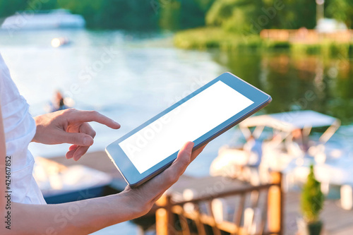 Canvas Print Mock-up of a tablet in the hands of a girl with a finger in front of the screen