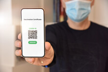Man Holding Mobile Phone With Digital Certificate Of Vaccination Against Covid-19, A Negative PCR Test Or Recovery From Covid-19. Travel Concept During Coronavirus Pandemic.