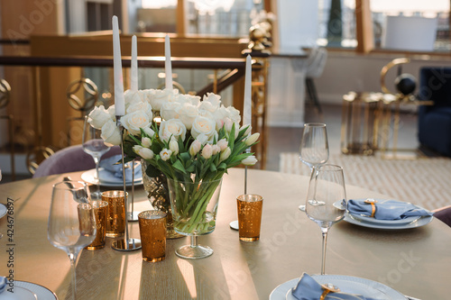 Obraz na plátně a bouquet of white roses on a preserved wooden table against the background of t
