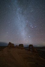 Delicate Arch And Winter Milky Way At Night. Arches National Park, USA.