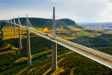 Aerial View Of Multispan Cable Stayed Millau Viaduct Across Gorge Valley Of Tarn River In Southern France In Summer