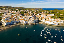 View From Drone Of Small Town Cadaques And Many Boats In Bay, Costa Brava, Spain, Famous Tourist Destination