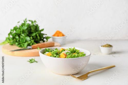 Obraz Bowl of fresh salad with vegetables on light background - fototapety do salonu