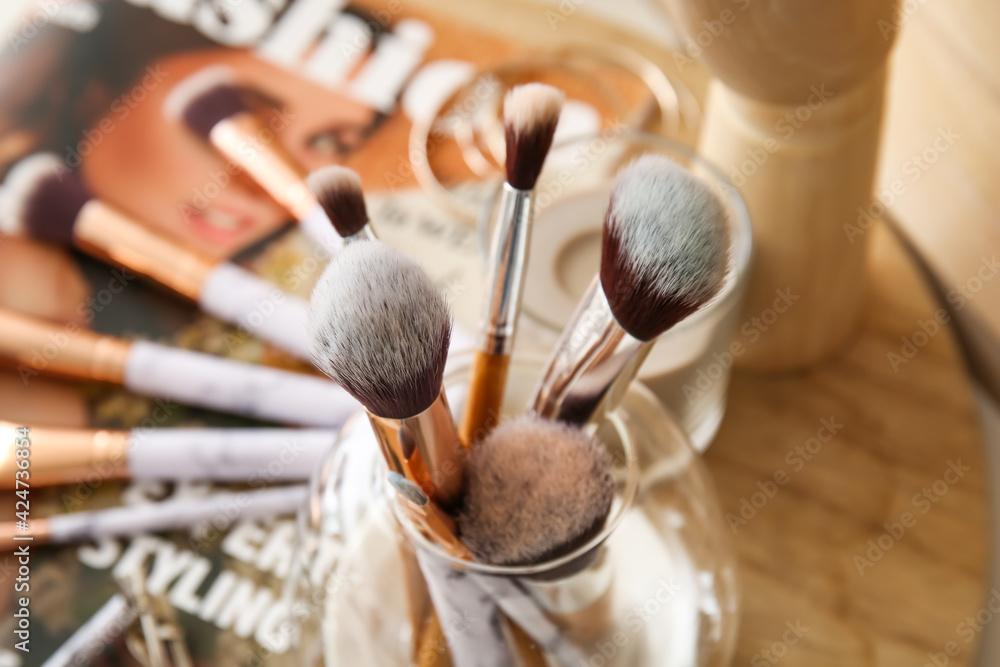 Fototapeta Set of makeup brushes in holder, closeup - obraz na płótnie