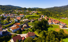 Picturesque Autumn Landscape Of Ljubljana Marshes Overlooking Brownish Roofs Of Houses Of Small Slovenian Town Of Vrhnika