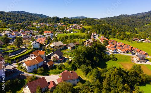 Fotografie, Obraz Picturesque autumn landscape of Ljubljana Marshes overlooking brownish roofs of