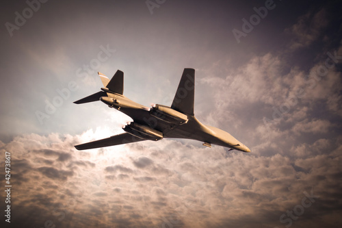 Foto Strategic bomber fighter airplane flying in the cloudy sky