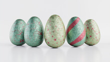 Easter Eggs Isolated Against A White Background. Chocolate Eggs Wrapped In Patterned Pale Green, Pale Blue And Pink Foil. 3D Render