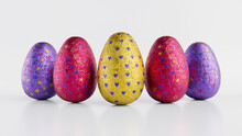 Easter Eggs Isolated Against A White Background. Chocolate Eggs Wrapped In Patterned Purple, Pink And Yellow Foil. 3D Render