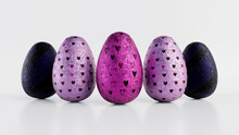 Easter Eggs Isolated Against A White Background. Chocolate Eggs Wrapped In Patterned Purple And Pink Foil. 3D Render