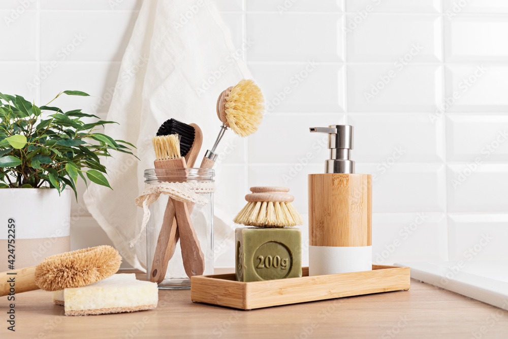Fototapeta Home cleaning non toxic, natural products. Washing dishen in kitchen with olive oil soap and brushes. Plastic free, zero waste, sustainable lifestyle idea - obraz na płótnie