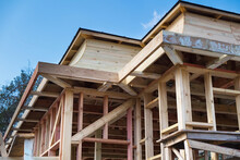 Installation Of Wooden Beams At Construction The Roof Truss System And Frame Of The House.